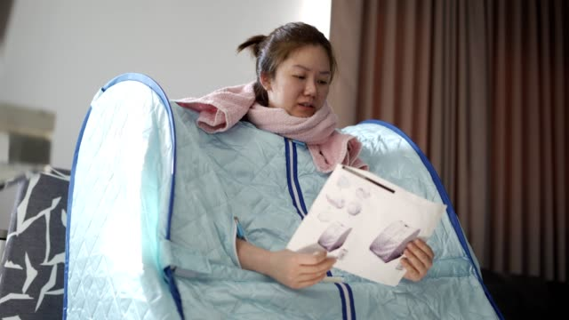 girl in portable sauna home relaxes  at home - sauna stock videos & royalty-free footage
