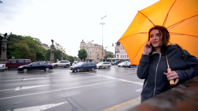 girl in rain talking on a smart phone - wap stock videos & royalty-free footage