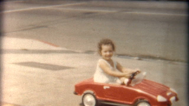 Girl in Red Car 1960's