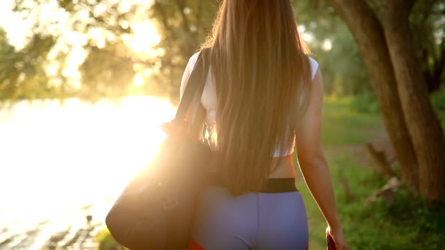 girl in sports after training returning home through the forest - leggings stock videos & royalty-free footage