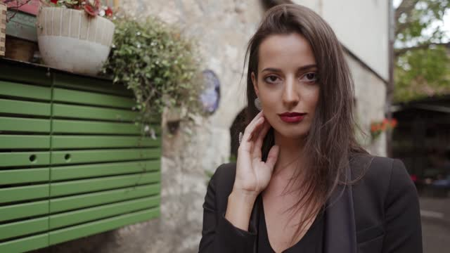 girl in the streets of old town sarajevo flirting with camera during the day by herself, in slow motion. - human limb stock videos & royalty-free footage
