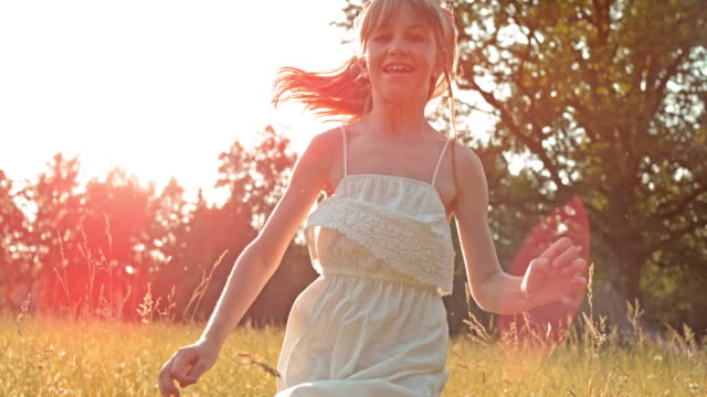 slo mo ts girl in white dress running in meadow - slovenia meadow stock videos & royalty-free footage