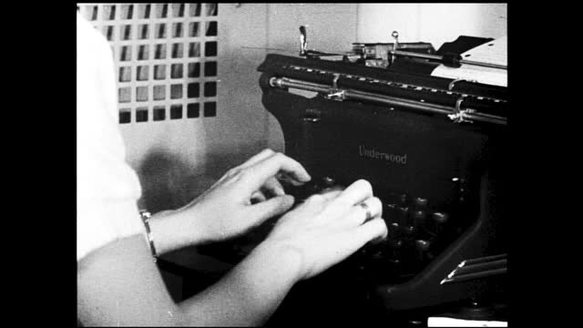 "vídeos y material grabado en eventos de stock de girl interviewed by manager and the two talks across the table; girl given steno and typing test using typewriter, labeled ""underwood""; girl talking... - 1940 1949"