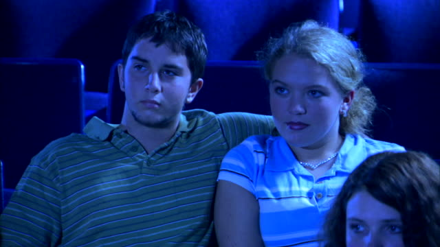 vidéos et rushes de a girl is annoyed with her boyfriend flirting with her and tells him to 'quit'. - flirter