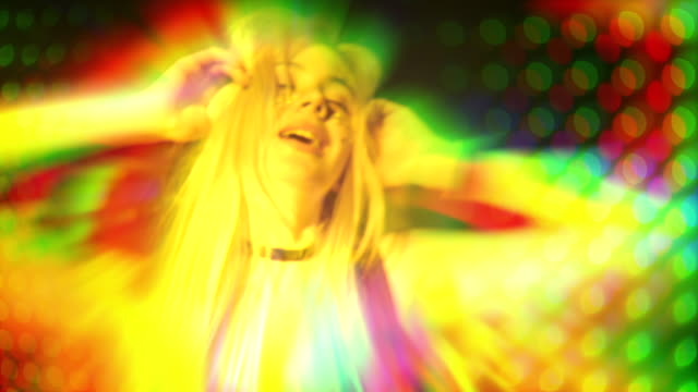 girl is glowing a tons of colors and dancing in club - illusion stock videos & royalty-free footage