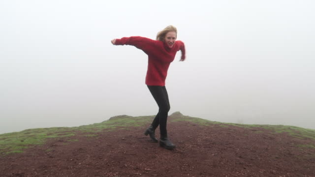 Girl is jumping in a deep fog