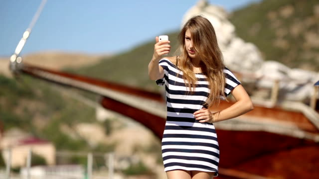 girl is photographed near the yacht - sailor stock videos & royalty-free footage