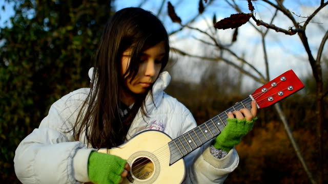 girl is playing guitar - formal glove stock videos and b-roll footage