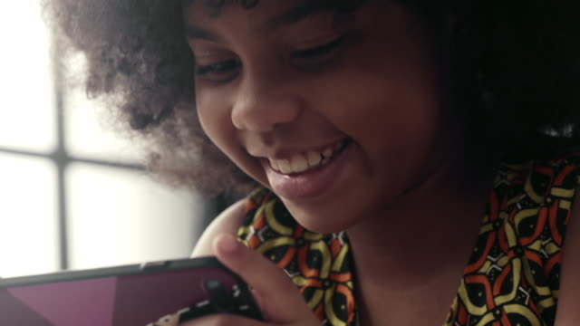 girl is playing on the smartphone - digital native stock videos & royalty-free footage