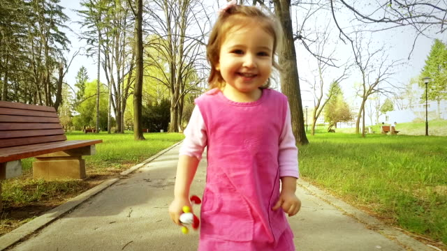 girl is running in the park. slow motion - one girl only stock videos & royalty-free footage