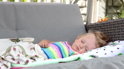 girl is sleeping on the garden swing. - resting stock videos & royalty-free footage
