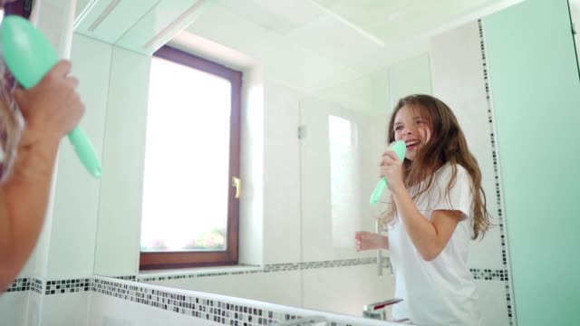 girl joyfully starts the day - domestic bathroom stock videos & royalty-free footage