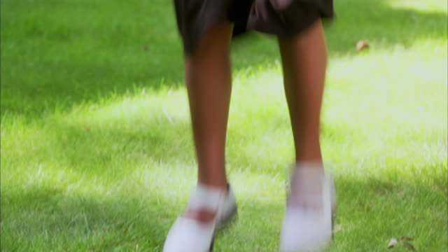 cu tu girl (6-7) jumping in garden, halifax, nova scotia, canada - see other clips from this shoot 1464 stock videos and b-roll footage
