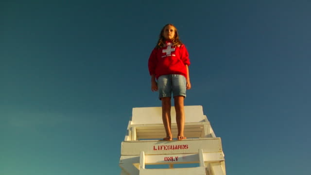 slo mo, ms, la, girl (10-11) jumping off lifeguard chair, provincetown, massachusetts, usa - lifeguard chair stock videos & royalty-free footage