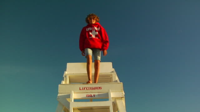 slo mo, ms, la, girl (12-13) jumping off lifeguard chair, provincetown, massachusetts, usa - lifeguard chair stock videos & royalty-free footage