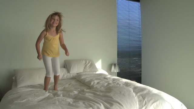 WS Girl (6-7) jumping on bed / Cape Town South Africa