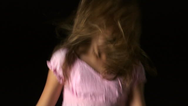 girl jumping up and down - altri spezzoni di questa ripresa 1162 video stock e b–roll