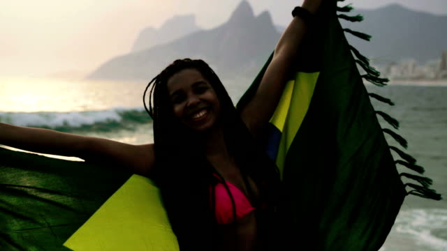 Girl jumping with Brazilian flag