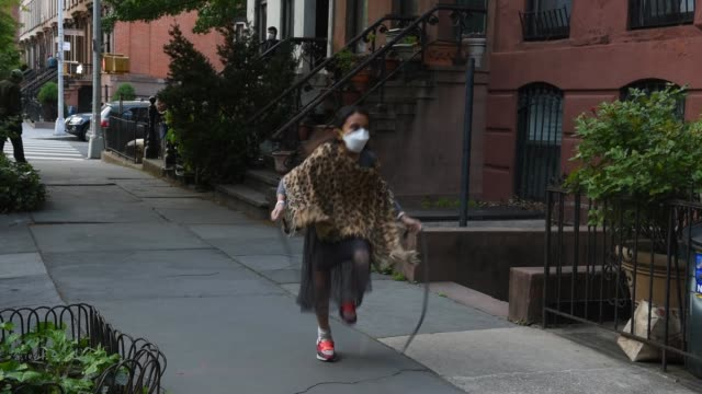 girl jumps rope as people dance on their stoop at 7:00 pm to honor frontline medical workers during the coronavirus pandemic on may 12, 2020 in the... - doorstep stock videos & royalty-free footage