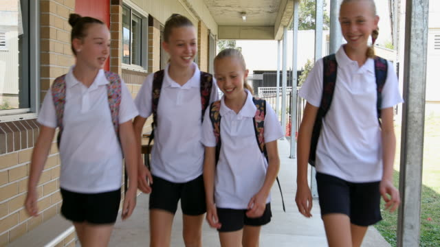 girl junior high school students arriving at school - last day stock videos & royalty-free footage
