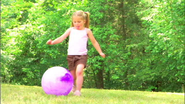 girl kicking a ball - see other clips from this shoot 1428 stock videos & royalty-free footage