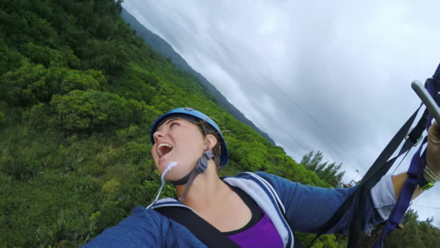 a girl laughs and screams with excitement as she ziplines - turtle bay hawaii stock videos & royalty-free footage