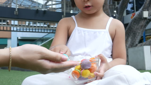 girl learning about color from macaroon - school meal stock videos & royalty-free footage