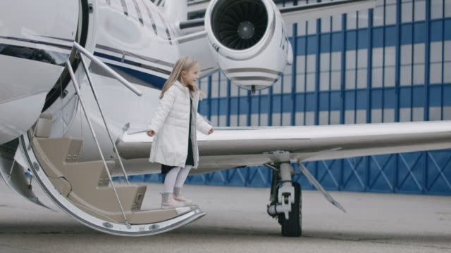 girl leaving the airplane - wealth stock videos & royalty-free footage