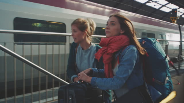 girl leaving with train - treno video stock e b–roll