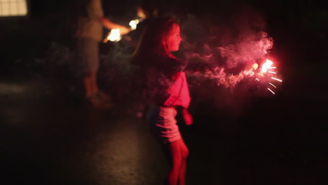 ms girl (6-7) lighting sparklers on 4th of july / lovell, maine, usa - sparkler stock videos & royalty-free footage