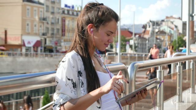 Girl listening to music and chatting on a tablet