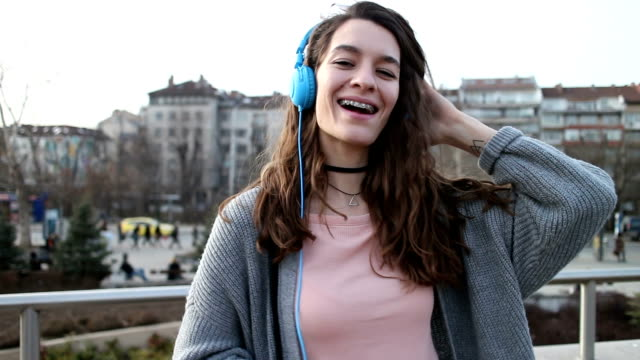 girl listening to music outside - brace stock videos and b-roll footage