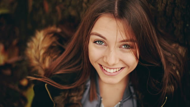 girl looking at camera and smiling - one teenage girl only stock videos & royalty-free footage