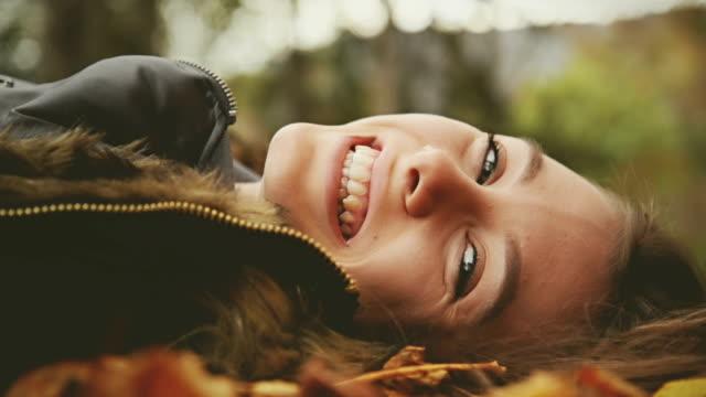Girl looking at camera and smiling.