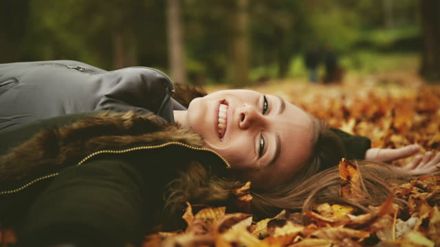 girl looking at camera and smiling. - lying on back stock videos and b-roll footage