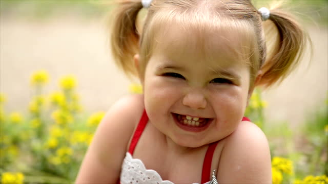 girl looking at camera. slow motion. - one baby girl only stock videos & royalty-free footage