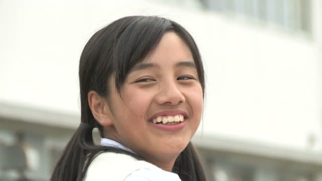 girl looking back and smiling - japanese school uniform stock videos & royalty-free footage