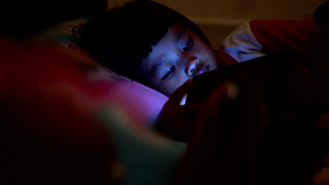 Girl Looking  Digital Tablet At Night.