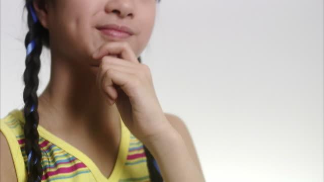 girl looking happy. - sideways glance stock videos & royalty-free footage
