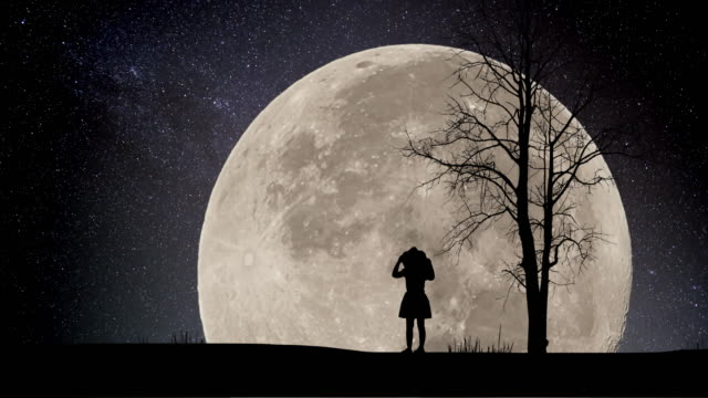 Girl looking Night Stars Time Lapse with supermoon background
