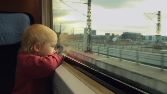 cu girl (2-3) looking out of train window / berlin, germany - passenger train stock videos & royalty-free footage