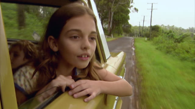 CU, Girl (10-11) looking through car window, Tamborine Mountain, Brisbane, Queensland, Australia