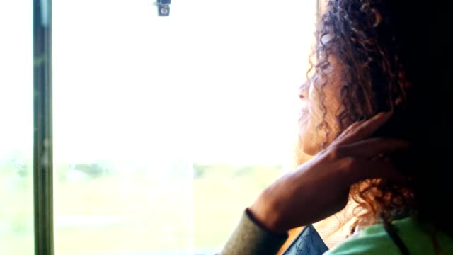 girl looking through window, driving in a bus - afro caribbean ethnicity stock videos and b-roll footage