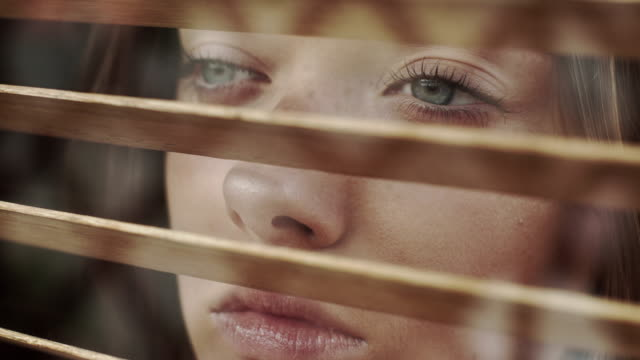 girl looks through blinds - blinds stock videos & royalty-free footage