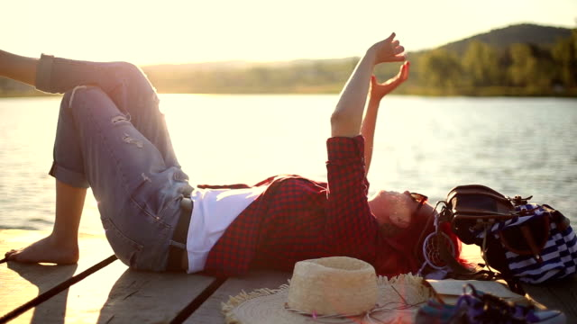 Girl lying down on a pier