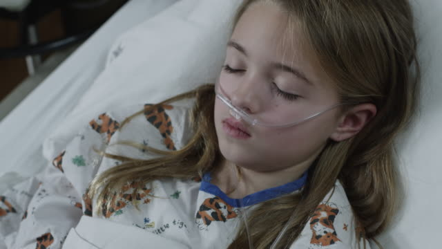 cu ds ha girl (8-9) lying in hospital bed / payson, utah, usa - payson stock videos & royalty-free footage