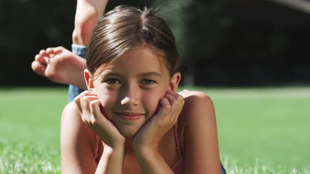 girl lying on the grass - pre adolescent child stock videos and b-roll footage