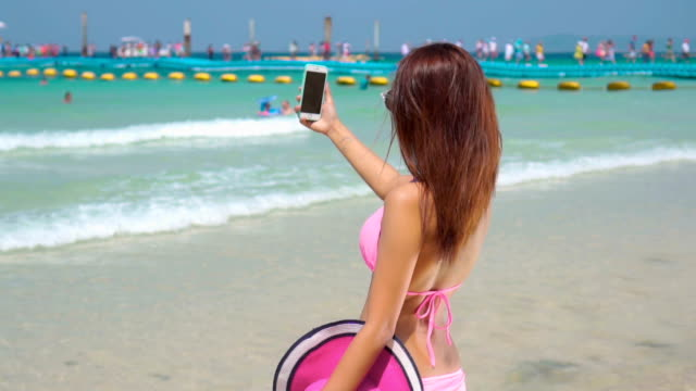 girl make selfie on beach,slow motion - one young woman only stock videos & royalty-free footage
