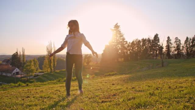 girl makes cartwheels in grass - cartwheel stock videos & royalty-free footage
