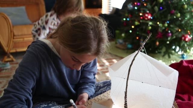 girl making a cardboard ship - nightdress stock videos & royalty-free footage